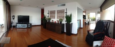 Panoramic view of living room. To the left access to ocean terrace and to the far right access to south terrace