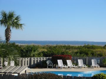 View of the ocean from the deck, overlooking the complex pool