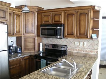 Well equipped kitchen; stainless steel appliances