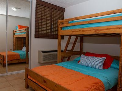 Second bedroom features a bunk bed with a full mattress and a twin upstairs.