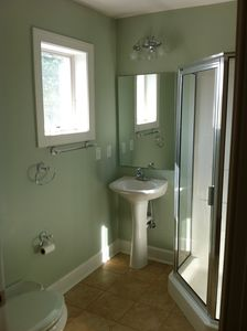 Four bathrooms look like this; Two are even bigger with full size tubs.