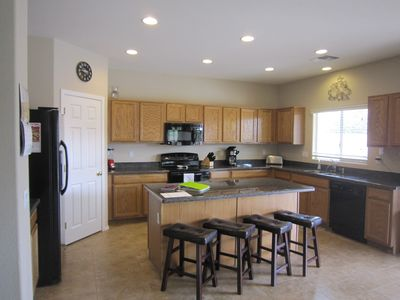 Large kitchen with granite countertops and considerable cooking space!