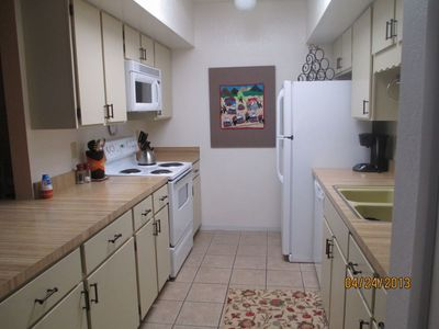 Full size kitchen, new frig, dishwasher, huge pantry is full sz door on rt