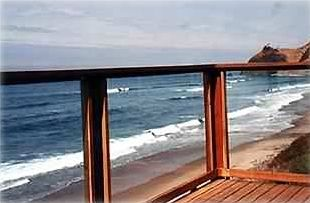 Enjoy panoramic ocean front view from large wrap around glass enclosed  deck