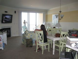 Belmont Towers Ocean City condo photo - Living Room w/ Dining, FP, Balcony, WiFi