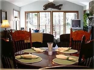 Enjoy dinner with your family, or cozy up to the fire in the stone fireplace.