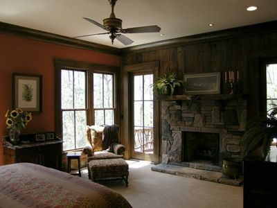 Master suite with fireplace and private covered porch over looking creek.