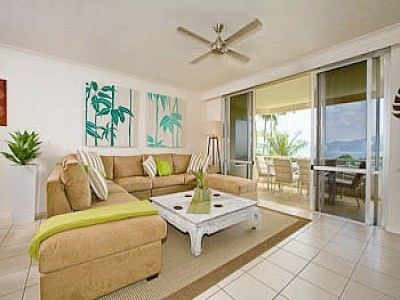 Hamilton Island apartment rental - Tropical themed lounge leading out the patio