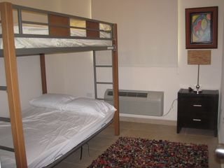 Aguadilla apartment photo - Second room with A/C, full size bunk beds that accomodate 4