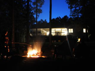 Swanton house photo - Enjoy an evening fire at the fire pit as the sun sets beyond the house.