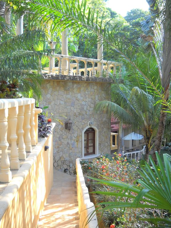 beautiful walkway to upper patios and infiniti pool and bathroom and showers