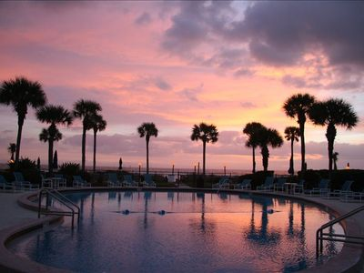 Sunrise over the pool and beach.