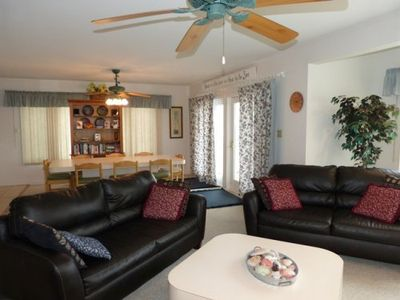 Relax in the spacious living room with 3 sofas and large flat screen TV