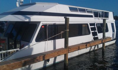 Houseboat Also Has Large Top Deck With Grill And Outdoor Table And Chairs.