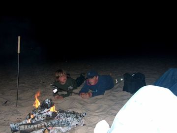 Roasting marshmellows over a campfire on the Lake Michigan beach.