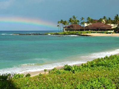 Poipu condo rental - Rainbow over Kiahuna Beach