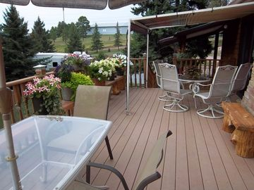 Flowers and sitting area on private deck.