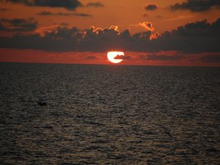 Sunnyside house photo - Enjoy the beautiful sunsets in the gulf from the beach.