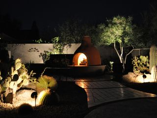 Scottsdale Troon house photo - East view of Kiva Fireplace, travertine terrace and lighted cactus beds!