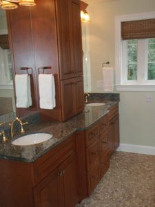 Master bathroom with double vanity in Cherry & granite