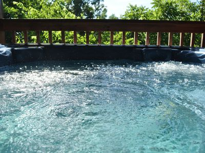 Soak in the Hot Tub while enjoying the peaceful scenery.