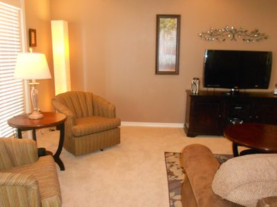 Comfortable Living Room with 42-in HDTV, cable, phone, wi-fi and the Lake view.