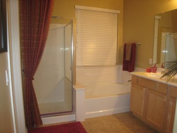 master bath has double sinks and private toilet area