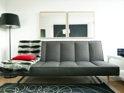 Our unit features a modern full size sofa sleeper within the modern decor