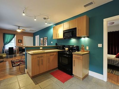 Kitchen has a new Gas Stove and Microwave with beautiful Tile Floors
