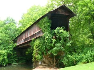 Logan Martin Lake cottage rental - Historic Waldo Covered Bridge in the Front Yard. photo by Beth Stewart
