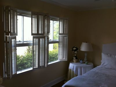 Luvered bedroom window blinds gives a  Casablanca feel