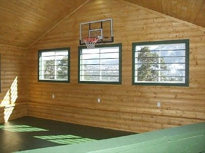 indoor basketball court (regulation height/rim/backboard).