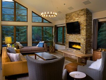 Comfortable and cozy living room with fireplace, HDTV and surround sound