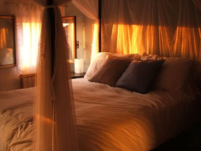 The romantic bedroom aglow at sunset