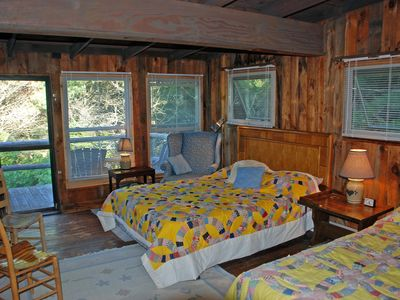 Independence cabin rental - Bdrm #3 upstairs;2 dbl beds;2 bunk beds;chest;chairs;balcony. Light & airy.
