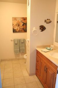 One bathroom with shower, sink, washer/dryer and toliet.