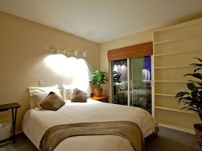 Queen-size bed bedroom with private balcony