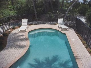 Sanibel Island house photo - Secluded heated pool max 6 foot depth with jacuzzi jets on sitting bench