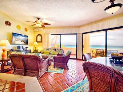 Large open floor plan with ocean view living & dining area with wrapping veranda