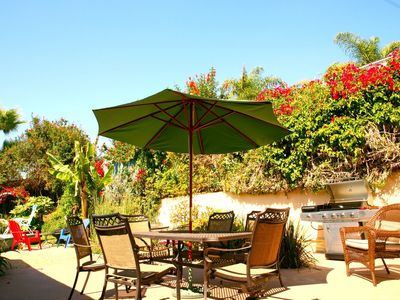 Enjoy the Private back patio with BBQ and seating for 14 with 3 tables
