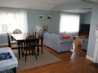 Falmouth house photo - The living room has a kitchen table great for lunch or games with an ocean view.