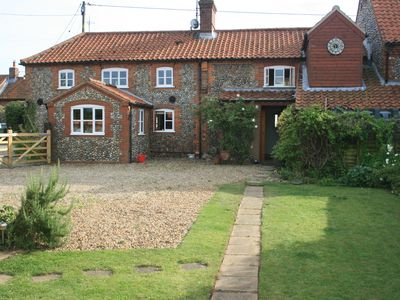 Pet friendly spacious 4 bedroom flint cottage with aga, outdoor pool and parking