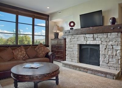 Family room with flat screen HDTV, gas fireplace, mountain views