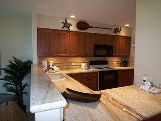 Kaanapali condo photo - Fully equiped kitchen, granite counter tops, cherry wood cabinets.