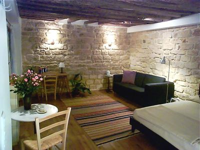 17th century stone walls and oak beams characteristic of the Marais