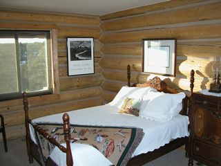 One of two private bedrooms on the main floor - Mesa Verde cabin vacation rental photo