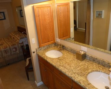 Master bath with dual sinks in granite counter tops