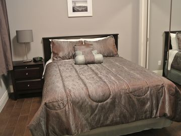 Bedroom 2 with queen size bed and nightstand.