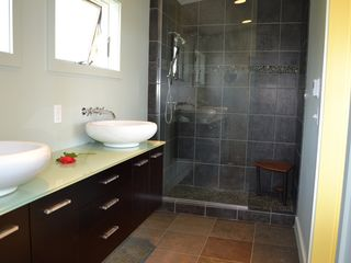 Bainbridge Island house photo - pebble floor shower and heated tiles in master bath