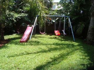 Fort Lauderdale house photo - Swingset in the fully fenced in backyard